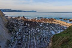 The Flysch, the rock formations of the beach of Zumaia or Itzurun in Guipuzcoa royalty free stock photos