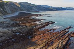 The Flysch, the rock formations of the beach of Zumaia or Itzurun in Guipuzcoa stock photo
