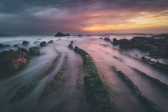 Flysch rocks in barrika beach at sunset. Flysch rocks in barrika beach at the sunset royalty free stock photography