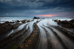 Flysch rocks in barrika beach at sunset Stock Photography