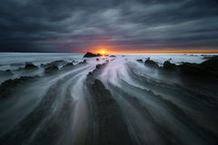 Flysch rocks in barrika beach at sunset Stock Images