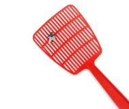 Flyswatter. Fly on a red flyswatter Stock Images