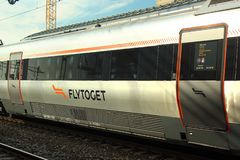Flytoget, the high-speed express in Drammen, Norway. Drammen, Norway - June 10, 2018: Flytoget, the high-speed Airport Express Train connecting Oslo Airport to royalty free stock photo