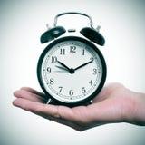 Flyttande fram klocka Arkivbild