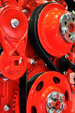 Flywheel and belt on vehicle engine. Flywheel, belt and other machine part of a diesel engine Stock Photo