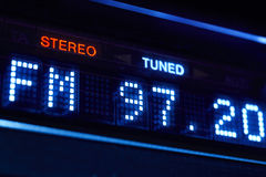 FM tuner radio display. Stereo digital frequency station tuned. Horizontal stock photography