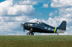 FM-2 Wildcat Against Sky on Runway royalty free stock photos