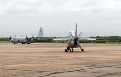 FMA IA-63 Pampa and Lockheed C-130 Hercules at I Air Brigade of El Palomar in Buens Aires Argentina. The IA-63 Pampa is an advanced jet trainer with combat royalty free stock photo
