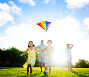 Fmaily Playing Kite Outdoors Royalty Free Stock Photos