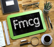 Fmcg Concept on Small Chalkboard. 3D. Royalty Free Stock Images
