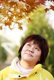 Fêmea chinesa no outono Imagem de Stock Royalty Free