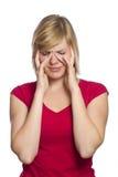 Fêmea loura que tem uma dor de cabeça Imagem de Stock Royalty Free