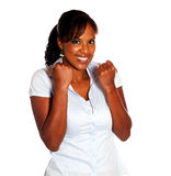 Fêmea nova excited feliz que comemora uma vitória Fotografia de Stock Royalty Free