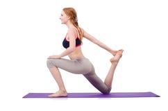 Fêmea nova que faz exercícios Fotografia de Stock