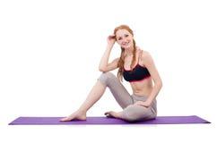 Fêmea nova que faz exercícios Fotografia de Stock Royalty Free