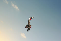 FMX biker jumping on a background of the sky. Extreme sport Royalty Free Stock Image