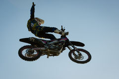 FMX rider performing trick Royalty Free Stock Image