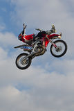 FMX stunt rider laying down on the job Royalty Free Stock Images