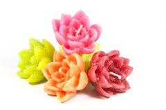 Fünf Mini Candles in der Form von Blumen Stockfotografie