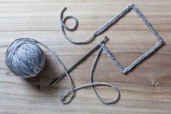 Fnitted rama na Drewnianym Fotografia Stock