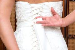 Fnuren i bröllopsklänning Royaltyfri Fotografi