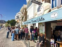 The shop is belongs to famous gummy ice cream producer Nazmi usta.People always waiting in the que. FOÇA, TURKEY - APRIL 29, 2017 : The shop is belongs to stock photo