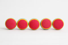 Foam Balls. 5 colourful foam balls in a line on a white background. Image shot on 5D Mark II and L lens royalty free stock image