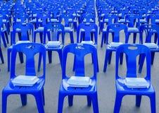 Foam box on blue  plastic chairs Stock Photos