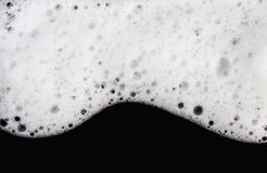 Foam bubbles abstract black background Royalty Free Stock Photography