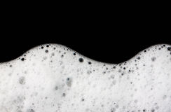 Foam bubbles abstract black background. Detergent Royalty Free Stock Photos