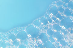Foam bubbles on blue  background Stock Photography