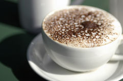 Foam on coffee drink. A large white cup with foam and sprinkled chocolate royalty free stock photo