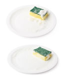 Foam covered sponge over ceramic plate. Foam covered dish washing kitchen sponge over the surface of the white ceramic plate, composition isolated over the white royalty free stock images
