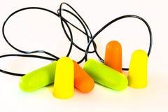 Foam ear plugs on white Stock Image