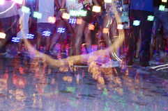 Foam feast. Blur to and out of focus a foam party with lights and music Stock Photography