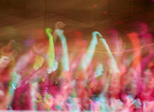 Foam feast. Blur to and out of focus a foam party with lights and music Royalty Free Stock Photography