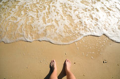 Foam and foot on sand Stock Images