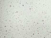 Foam formed on a latte royalty free stock photos