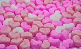 Foam hearts background. Background with pink, peach and white foam hearts with clear foreground and blur background stock image