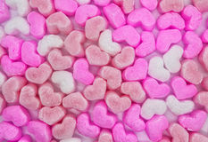 Foam hearts background. Background with pink, peach and white foam hearts. View from above Royalty Free Stock Images