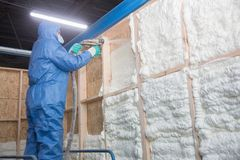 Free Foam Is Applied To The Walls To Warm The House Stock Photos - 161338413