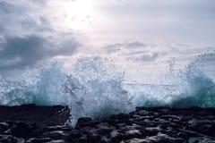 Massive waves pound the Irish Coast. The foam from a massive wave crashes onto the tidal pool on the western Irish Coast Royalty Free Stock Image