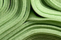 Foam material. Close up of rolled up green foam material mats for construction purpose stock photography