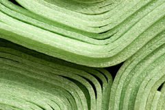 Foam material. Close up of rolled up green foam material mats for construction purpose stock images