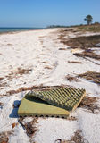 Foam mattress littering a beach Stock Images