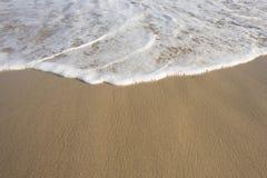 Foam from Ocean on Beach Royalty Free Stock Image