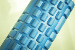 Foam physiotherapy roller. Foam physiotherapy, fitness sports self massage roller used to roll out tired, sore muscles, tension, strains and to increase muscle Stock Image