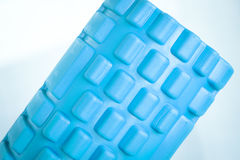 Foam physiotherapy roller. Foam physiotherapy, fitness sports self massage roller used to roll out tired, sore muscles, tension, strains and to increase muscle Royalty Free Stock Images
