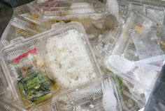 Foam and plastic food container in the bin Stock Photography