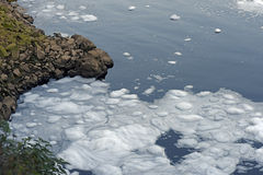 Foam of pollution on the Tiete River Stock Photos